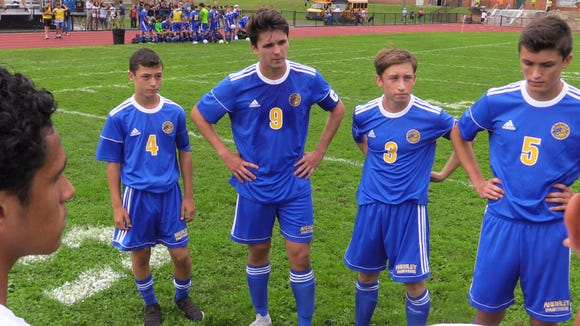 Matthew Halperin, left, joins the captains meeting with the referees and teammates, during their boys soccer game against New Rochelle at Ardsley High School, Aug. 31, 2018. Matthew's brother Harris, who would have been a senior and a captain, passed away from cancer and the team has made his younger brother an honorary captain.