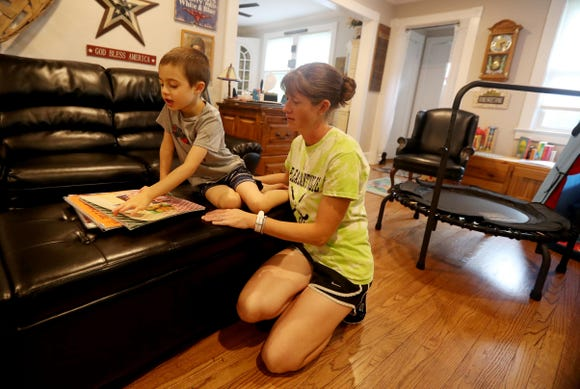 Kristen Coffey, head coach of the Pleasantville High School varsity field hockey team, spends time with her 6-year old autistic son Peyton at their home in Pleasantville Aug. 31, 2018. Coffey has organized a field hockey tournament to benefit the autism advocacy organization Autism Speaks. The tournament will take place Sept. 8, 2018, at Pleasantville High School.