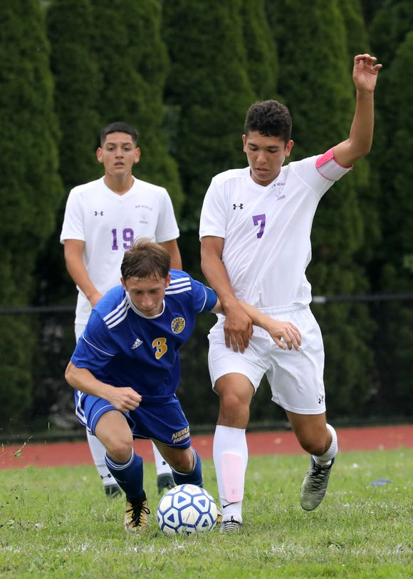 Ardsley's Samuel Hirth and New Rochelle's Johan Velez in action during their boys soccer game at Ardsley High School, Aug. 31, 2018.