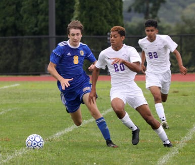 New Rochelle's Aaron Blake and Ardsley's Luke Sokich in action during their boys soccer game at Ardsley High School, Aug. 31, 2018.