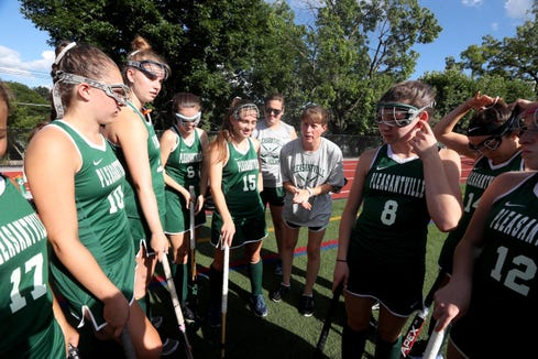 Kristen Coffey, head coach of the Pleasantville High School varsity field hockey team, talks to her team before a game against White Plains Aug. 30, 3018. Coffey, who's six year-old son Peyton has autism, has organized a field hockey tournament to benefit the autism advocacy organization Autism Speaks. The tournament will take place Sept. 8th at Pleasantville High School.