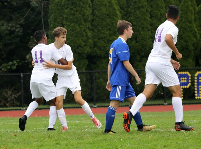 New Rochelle's Connor Burke (facing camera) celebrates a goal with teammate Chris Collins, during their boys soccer game  against Ardsley, at Ardsley High School, Aug. 31, 2018.