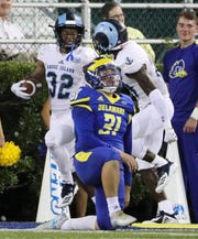 Delaware punter Nick Pritchard reacts as Rhode Island's Justice Antrum (left) celebrates his touchdown off a bad snap on a punt attempt in the second quarter at Delaware Stadium Thursday.