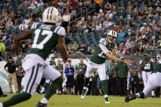 Jets quarterback Josh McCown (15) throws to receiver Charone Peake (17) Thursday at Lincoln Financial Field.