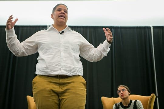Kerri Harris, a progressive political newcomer who is hoping to follow in Ocasio-Cortez's footsteps by defeating U.S. Sen. Tom Carper in Delaware's Democratic primary on Sept. 6, speaks to supporters at the Newark Town Hall at the Trabant Center.