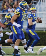 Delaware starting quarterback Pat Kehoe looks to tight end Charles Scarff in the first quarter against Rhode Island at Delaware Stadium Thursday.