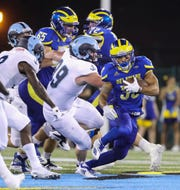 Delaware's DeJoun Lee gains ground in the first half at Delaware Stadium Thursday.