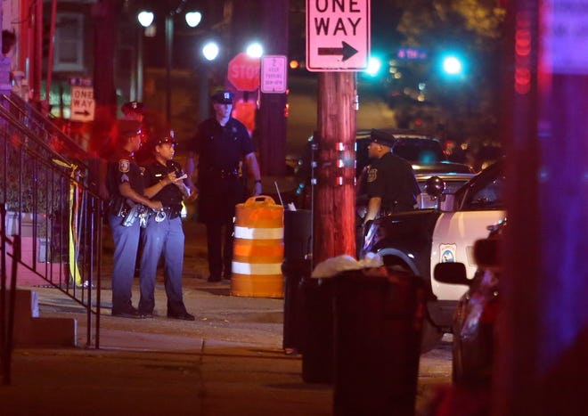 Police investigate after a person was shot in the 200 block of N. Van Buren Street in Wilmington about 1 a.m. Friday.