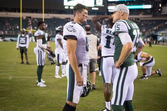 Eagles quarterback Christian Hackenberg (8) speaks with Jets quarterback Josh McCown (15) Thursday, Aug. 30, 2018 at Lincoln Financial Field.