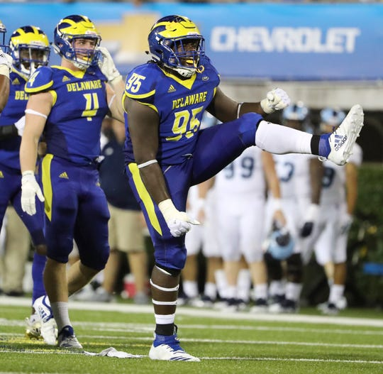 Delaware's Frank Burton III celebrates a sack in the third quarter of the Blue Hens' 21-19 loss at Delaware Stadium Thursday.