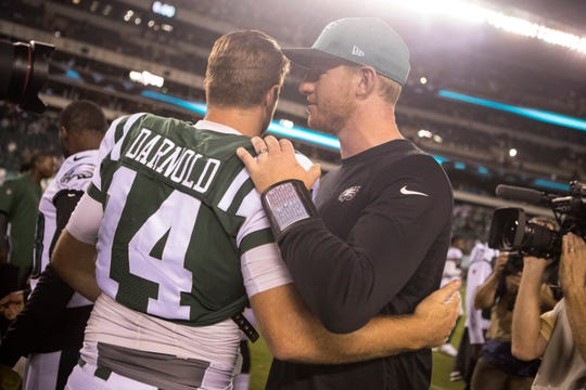 Eagles quarterback Carson Wentz, right, speaks with Jets quarterback Sam Darnold (14) Thursday at Lincoln Financial Field.