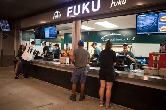 Eagles fans grab food at Fuku, a new concession stand at Lincoln Financial Field.