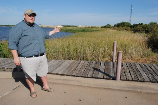 Tom Lang, Texas Parks and Wildlife fish biologist and Lake Wichita Revitalization member, talks Friday at Lake Wichita about three projects - a boat ramp/seawall, boardwalk/pavilion and veteran's memorial plaza - that are going into the design phase.