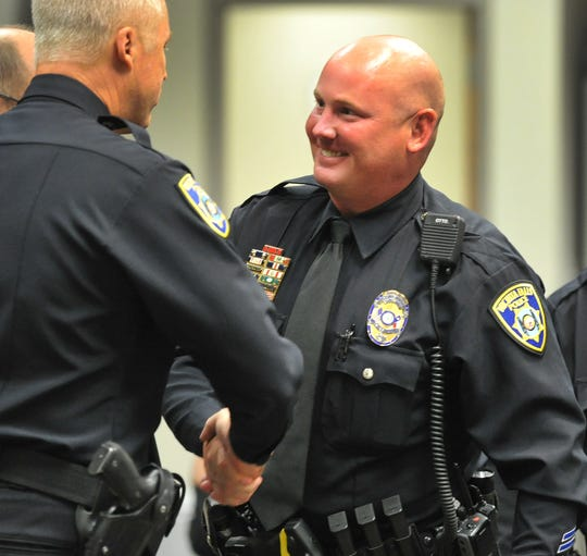 Wichita Falls Police Officer Jason Leavelle, right, talks with Deputy Chief Guy Gilmore after being promoted to Sergeant during a Retirement, Promotion and Award Ceremony Friday morning.