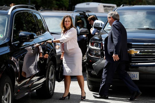 Canada's Foreign Affairs Minister Chrystia Freeland, left, walks to a car during a break in trade talk negotiations from the Office of the United States Trade Representative, Thursday, Aug. 30, 2018, in Washington. At right is David MacNaughton, Canada's Ambassador to the United States.
