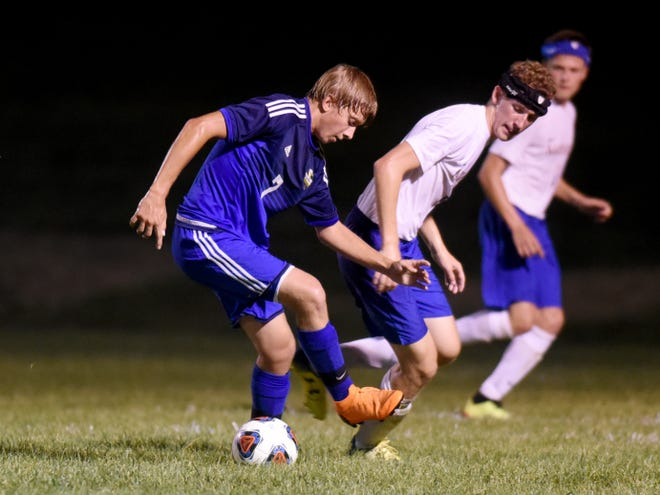 Cayden Porter, of West Muskingum, and Ethan Garrett, of Maysville, fight for possession during their match on Thursday night at West. It ended in a 1-1 tie.