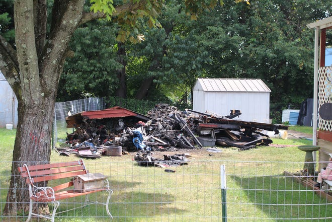 The fire marshal is investigating what started the fire that burned down the shed.