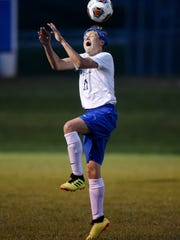Tyler Lantz, of West Muskingum, goes up for a header during their match on Thursday against visting Maysville. The teams tied, 1-1.