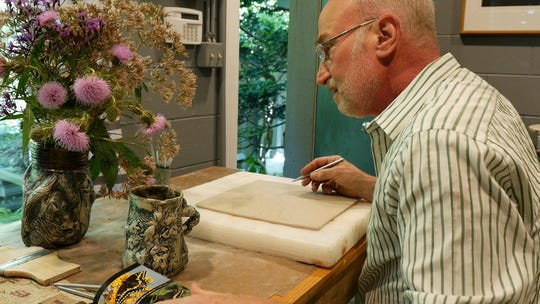 Michael J. Rosen working on an art piece for the Foot by Foot art exhibition.