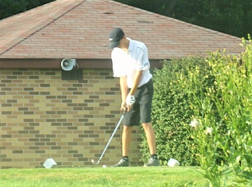 Ridgewood's Gauge Shaw gets ready to tee off during Thursday's match with Strasburg at River Greens.