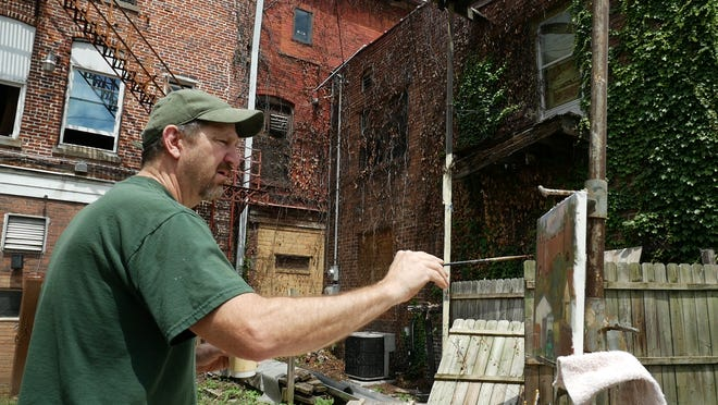 Paul Emory working on a piece for the Foot by Foot art exhibition.