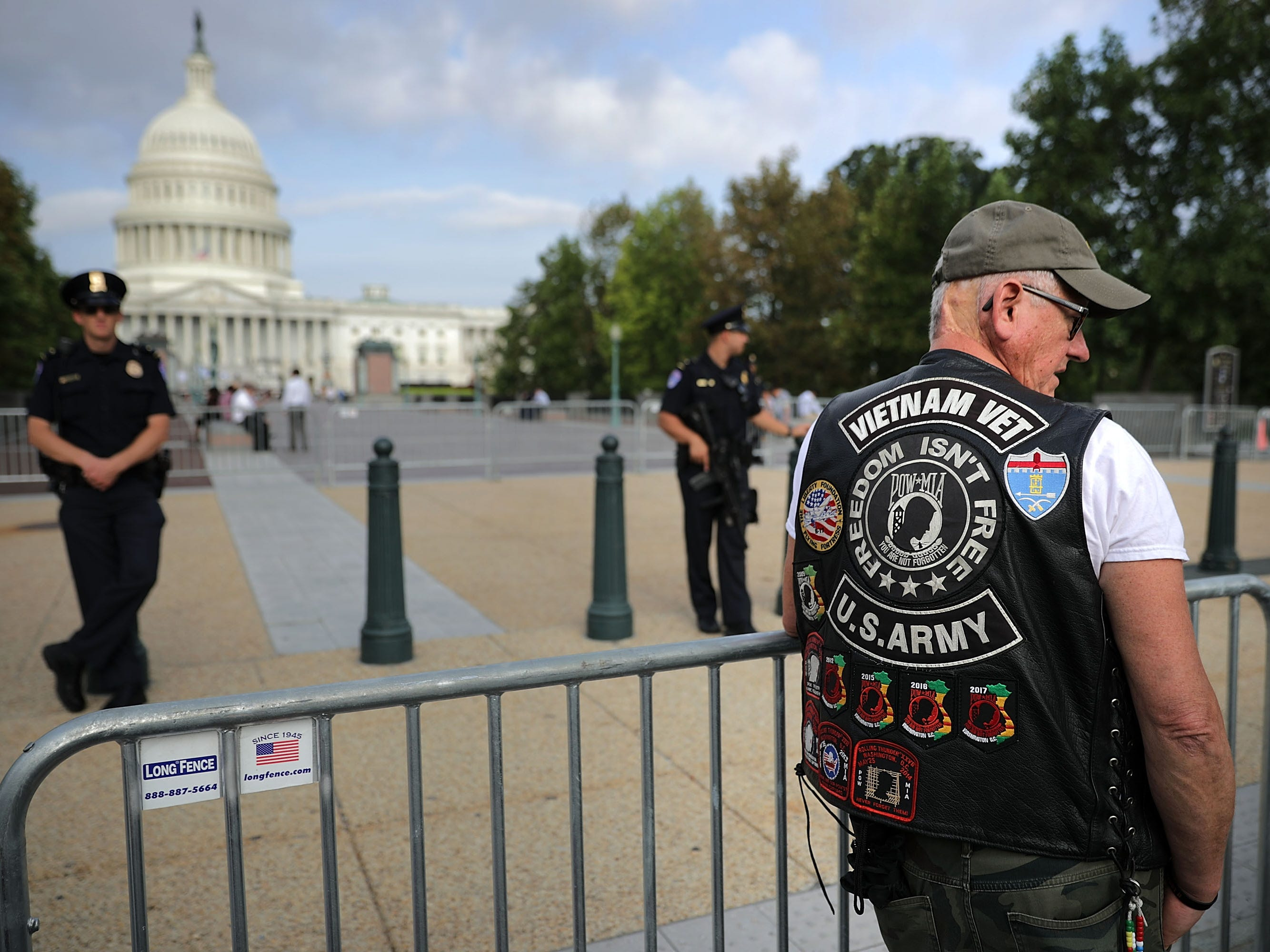 "WASHINGTON, DC - AUGUST 31:  Vietnam War veteran Gary Galloway of Fort Knox, Kentucky, stands in line to pay respects to Sen. John McCain (R-AZ) when he lies in state later in the dat at the U.S. Capitol August 31, 2018 in Washington, DC. ""We were brothers,"" Galloway said of McCain. ""All military people are brothers when it comes down to it."" The late senator died August 25 at the age of 81 after a long battle with brain cancer. He will lie in state at the U.S. Capitol Friday, a rare honor bestowed on only 31 people in the past 166 years. Sen. McCain will be buried at his final resting place at the U.S. Naval Academy on Sunday.  (Photo by Chip Somodevilla/Getty Images) ORG XMIT: 775217654 ORIG FILE ID: 1025510204"