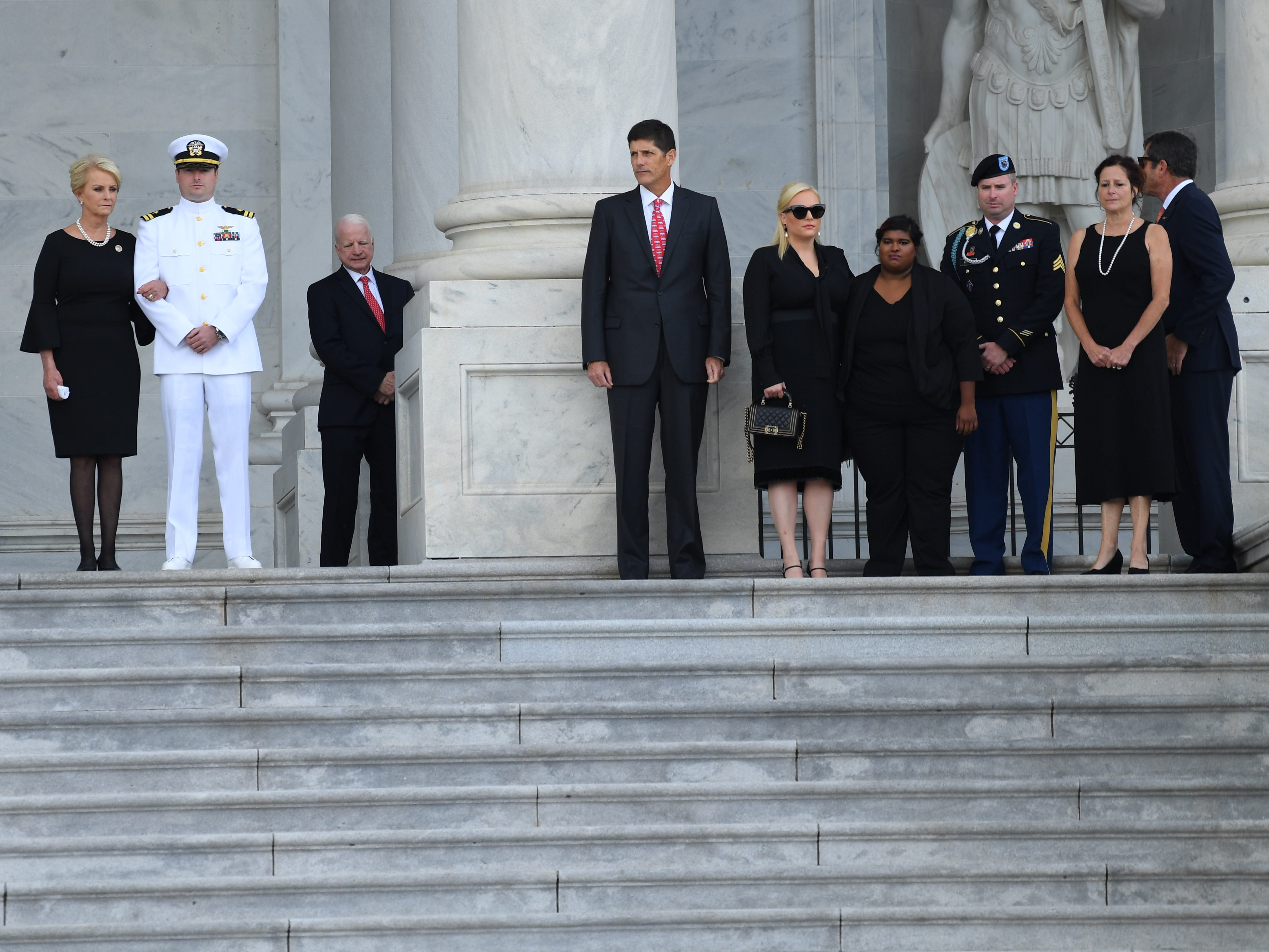 8/31/18 10:43:21 AM -- Washington, DC, U.S.A  -- The casket of John McCain arriving at the U.S. Capitol while the McCain family waits on Aug. 31, 2018 in Washington. Sen. McCain died on Aug. 25. --    Photo by Jack Gruber, USA TODAY Staff` ORG XMIT:  JG 137435 McCain U.S. Capi 8/31 (Via OlyDrop)