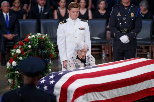 Roberta McCain, 106, takes a moment at the casket of her son, Sen. John McCain, after a memorial service in the Rotunda of the U.S. Capitol, where he lay in state Aug. 31, 2018.