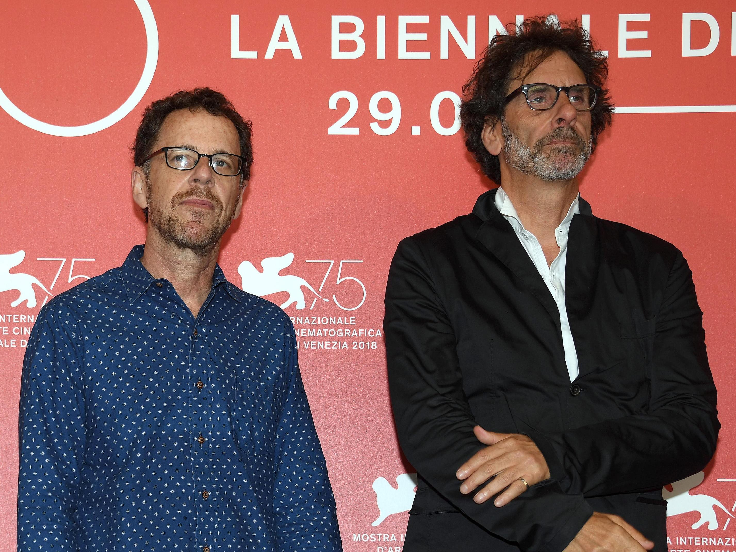 """Directors Joel (right) and Ethan Coen, pose during a photocall for their Netflix movie """"The Ballad of Buster Scruggs"""" during the 75th annual Venice International Film Festival, in Venice, Italy, 31 August 2018. The movie is presented in the official competition 'Venezia 75' at the festival running from 29 August to 08 September 2018.  EPA-EFE/CLAUDIO ONORATI"""
