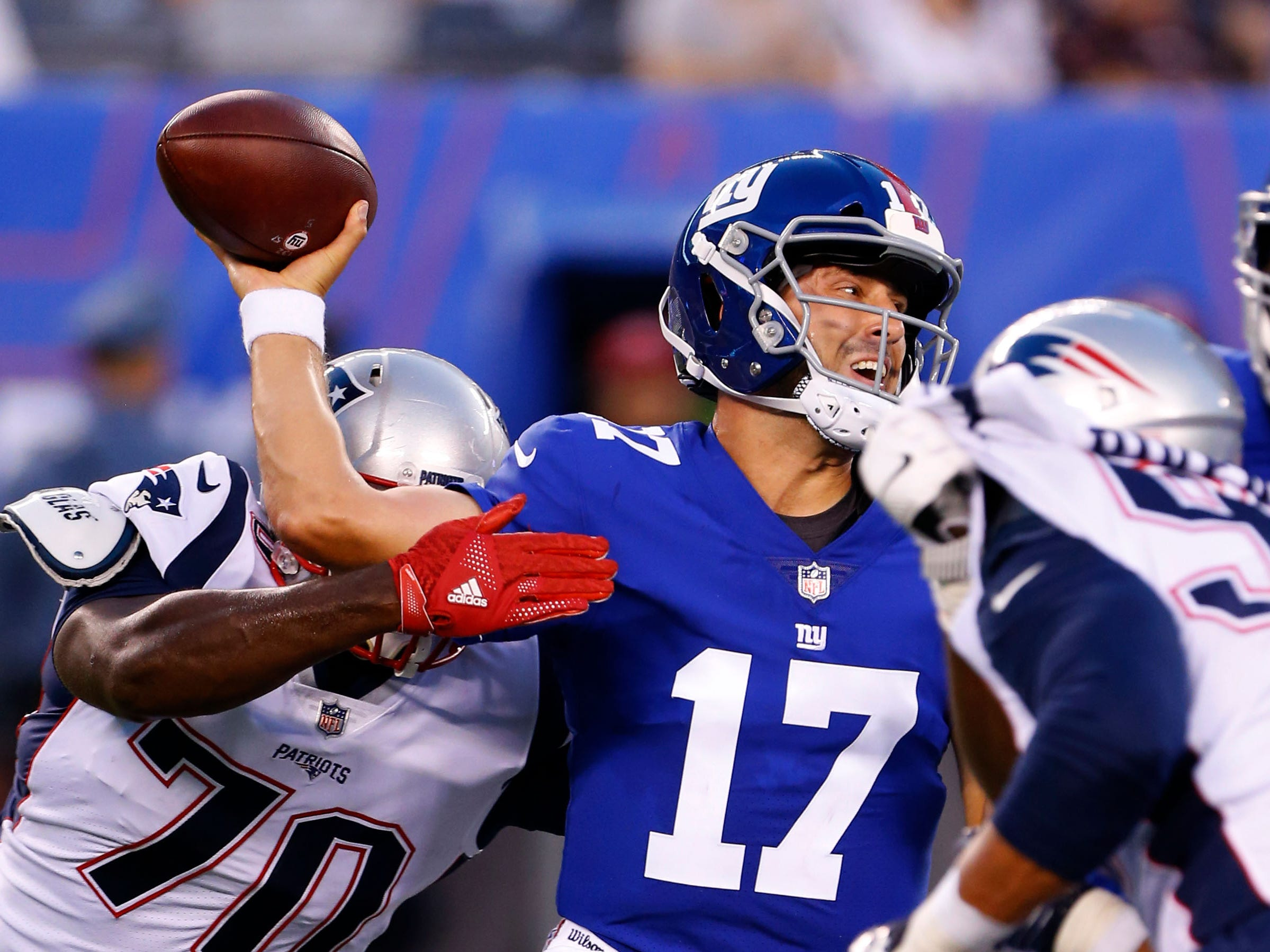 New York Giants quarterback Kyle Lauletta attempts to pass against New England Patriots defensive tackle Adam Butler (70) during first half at MetLife Stadium.