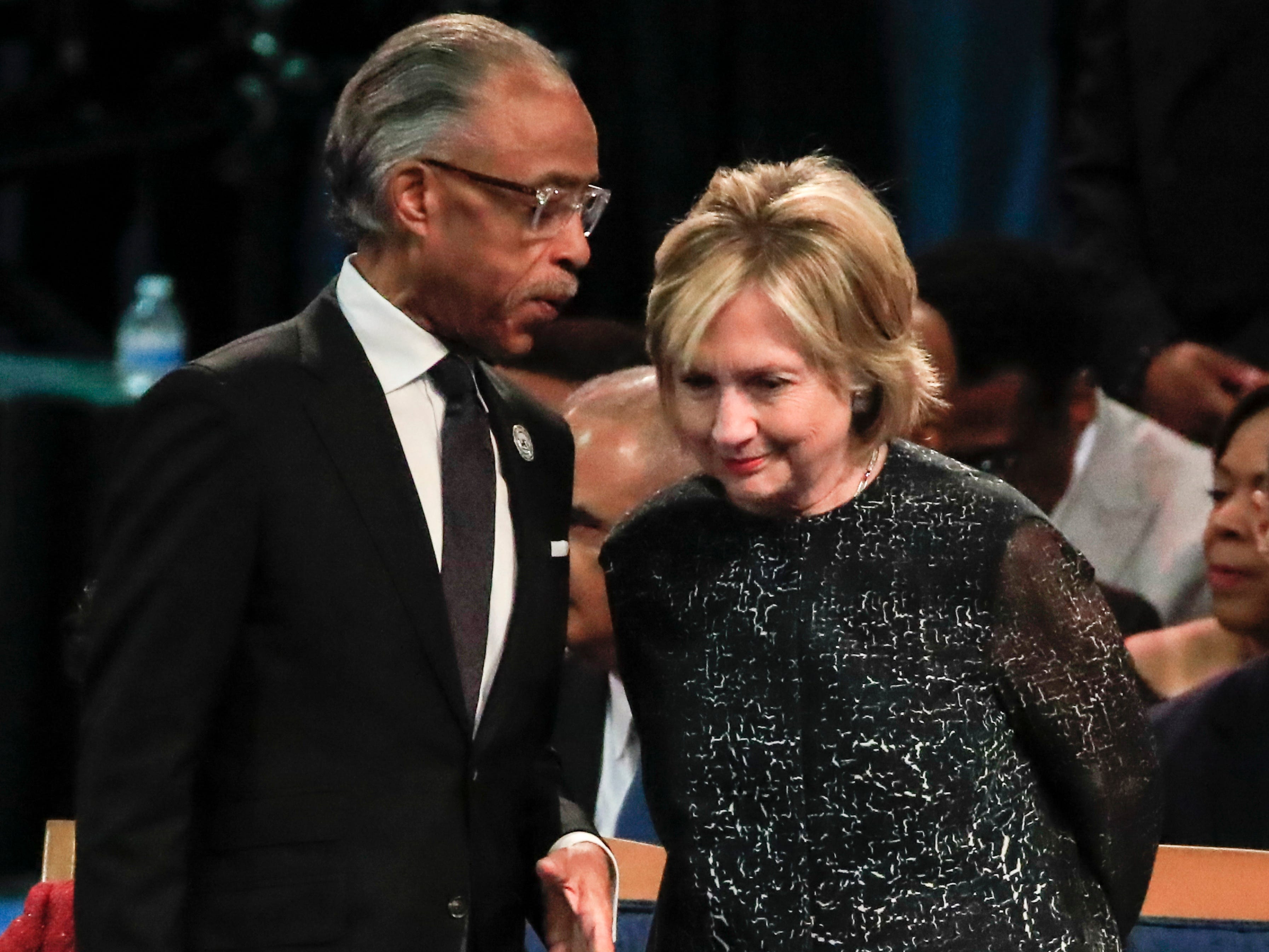 epa06987290 The Reverend Al Sharpton talks with Hillary Clinton before the start of funeral services for US singer Aretha Franklin at the Greater Grace Temple in Detroit, Michigan, USA, 31 August 2018. Aretha Franklin, known as the Queen of Soul for recording hits such as RESPECT, Chain of Fools and many others, died 16 August 2018 from pancreatic cancer and will be buried in Woodlawn Cemetery on 31 August.  EPA-EFE/TANNEN MAURY ORG XMIT: THM11