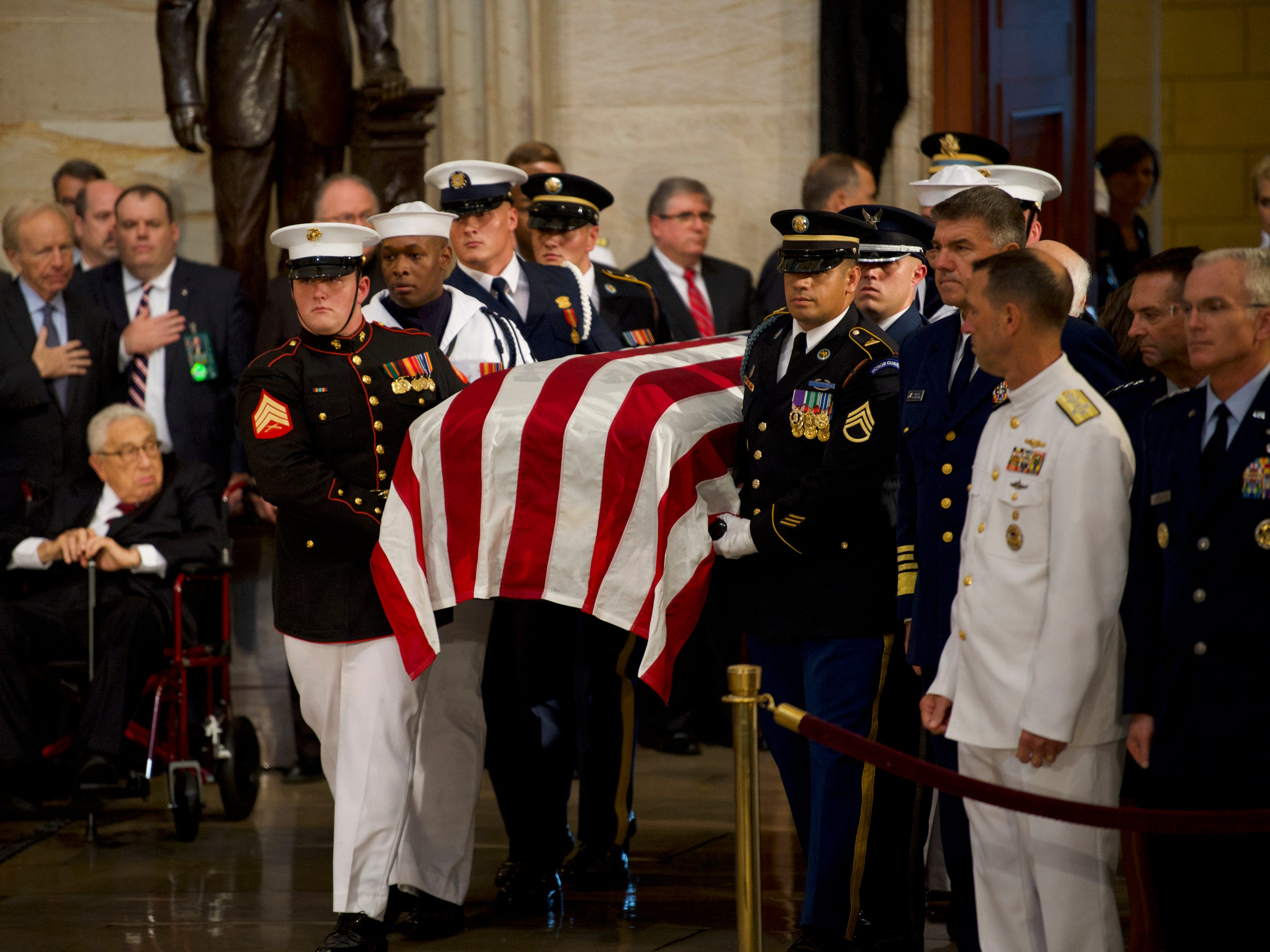 8/31/18 10:52:05 AM -- Washington, DC, U.S.A  -- The body of John McCain is carried in before he lies in state at the U.S. Capitol in Washington on Aug. 31, 2018 in Washington. Sen. McCain died on Aug. 25. --    Photo by Jasper Colt, USA TODAY Staff ORG XMIT:  JC 137436 McCain U.S. Capi 8/31/2018 (Via OlyDrop)
