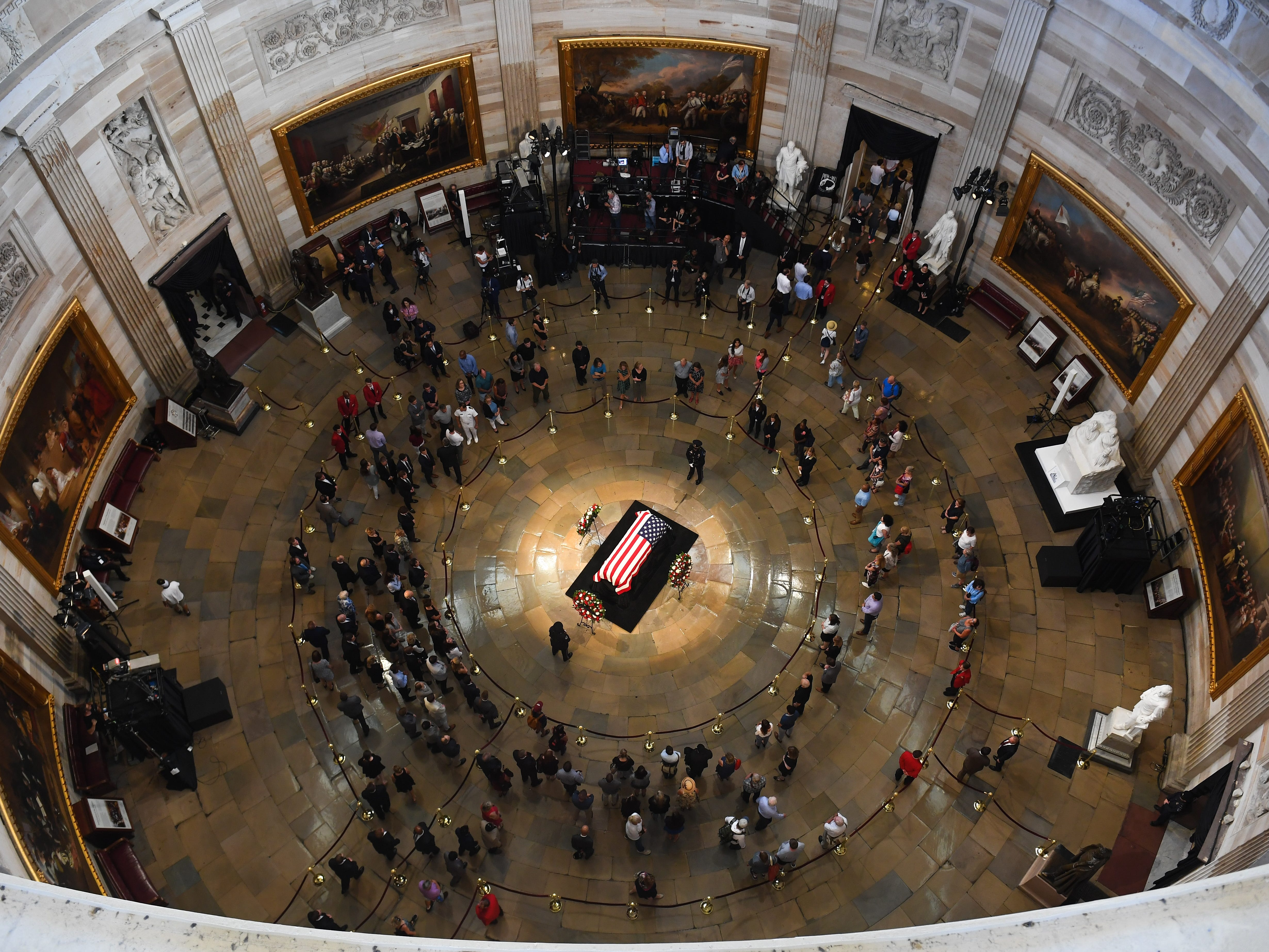 8/31/18 1:57:44 PM -- Washington, DC, U.S.A  -- The body of John McCain lying in state at the U.S. Capitol in Washington on Aug. 31, 2018 in Washington. Sen. McCain died on Aug. 25. --    Photo by Jack Gruber, USA TODAY Staff ORG XMIT:  JG 137435 McCain U.S. Capi 8/31 (Via OlyDrop)