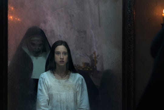 "Sister Irene (Taissa Farmiga) is haunted by the demonic nun Valak (Bonnie Aarons) in the ""Conjuring"" spinoff ""The Nun."""