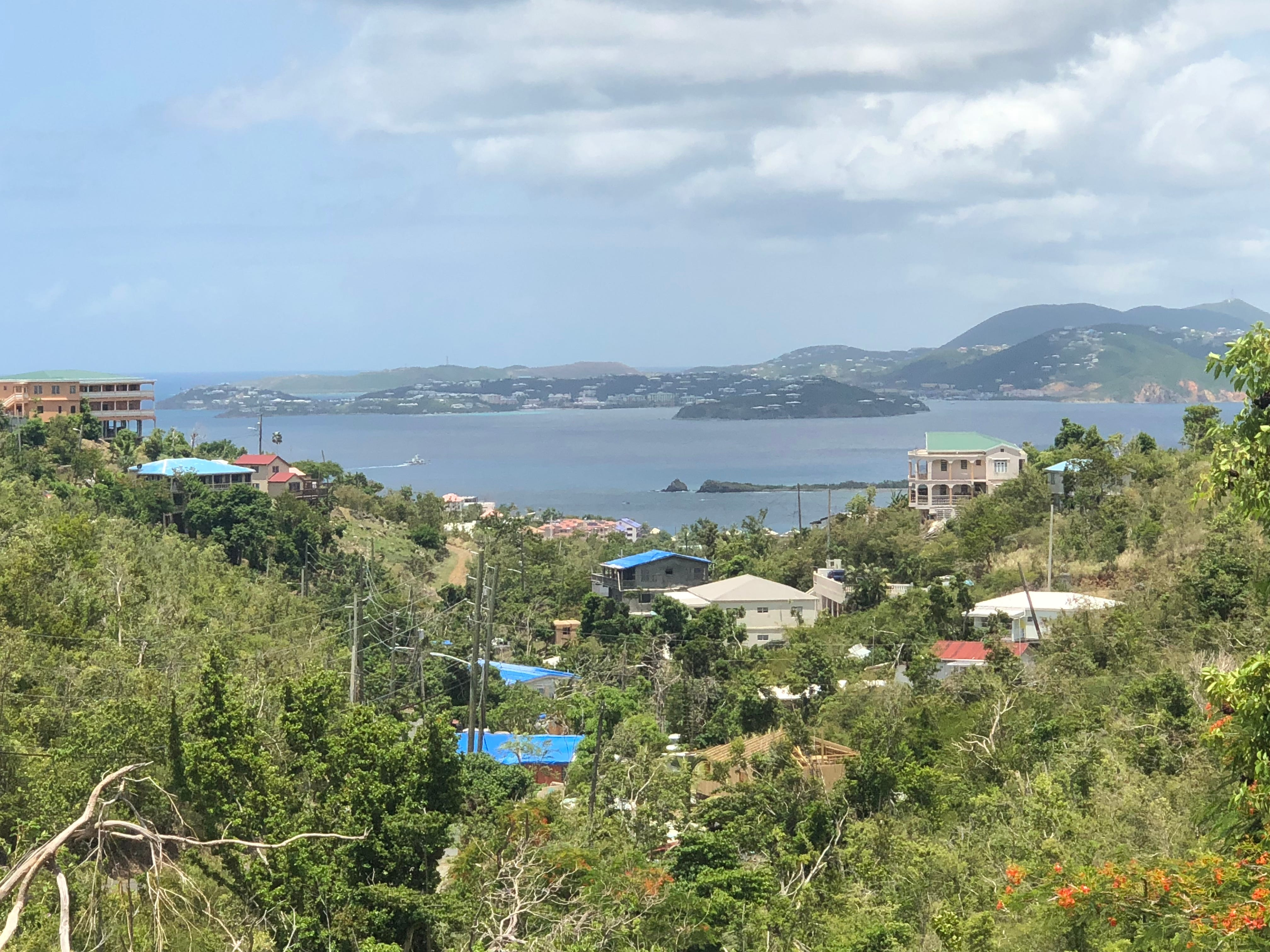 Blue tarps covering damaged or missing roofs still dot the St. John landscape, a year after Hurricane Irma battered the U.S. territorial island.