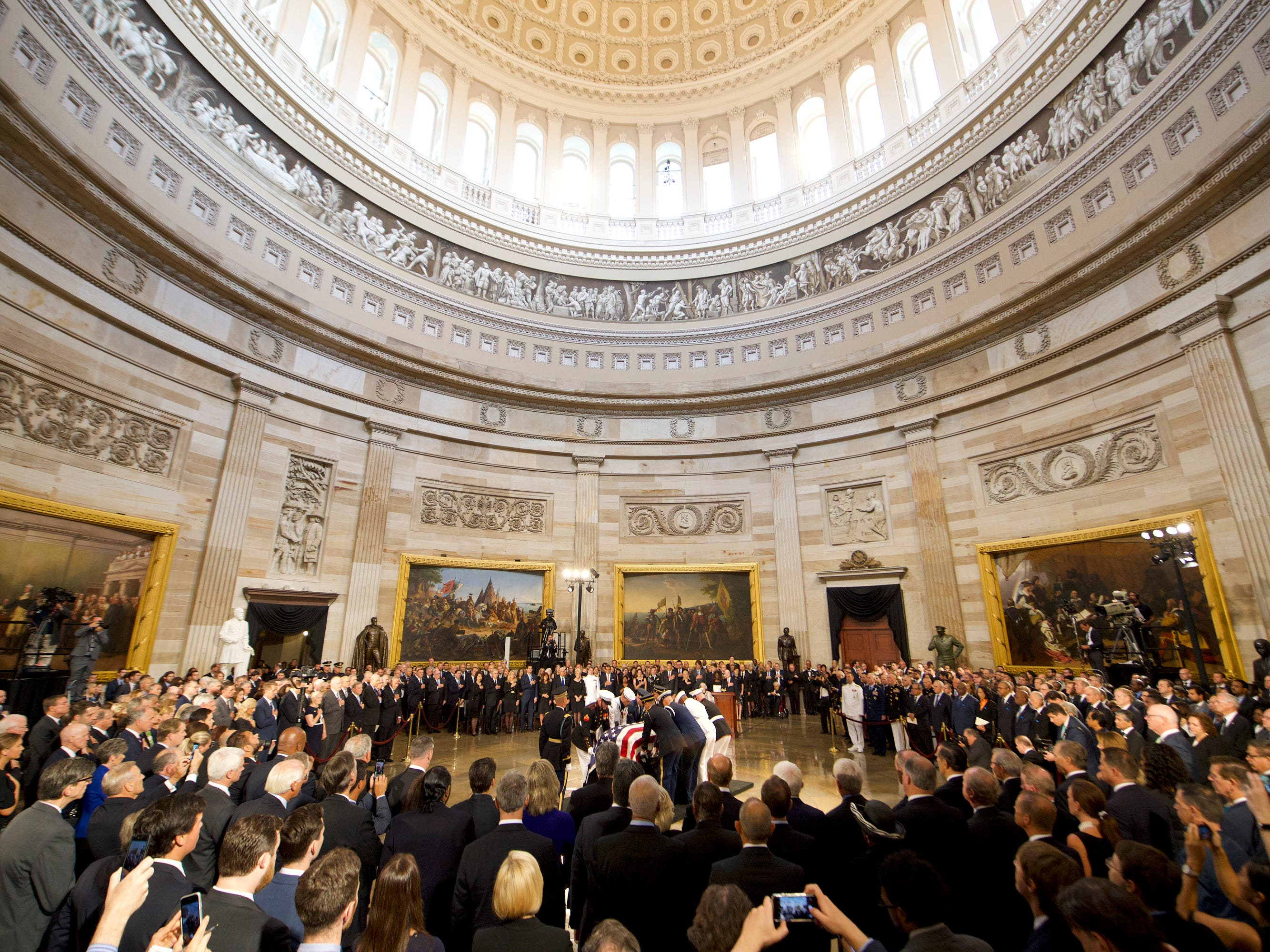 8/31/18 11:53:07 AM -- Washington, DC, U.S.A  -- The body of John McCain is carried in before he lies in state at the U.S. Capitol in Washington on Aug. 31, 2018 in Washington. Sen. McCain died on Aug. 25. --    Photo by Jasper Colt, USA TODAY Staff ORG XMIT:  JC 137436 McCain U.S. Capi 8/31/2018 (Via OlyDrop)