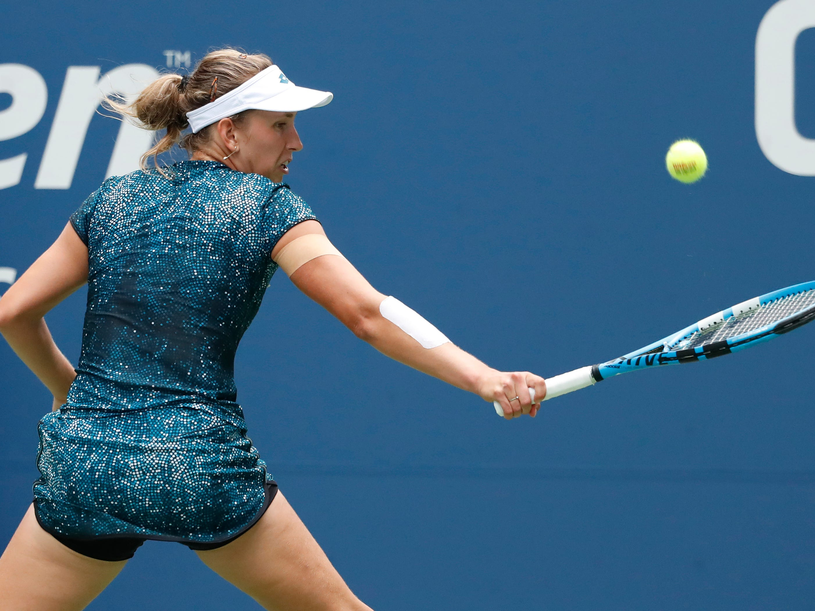 Belgium's Elise Mertens, the No. 15 seed, reaches for a backhand during her 6-3, 7-6 (7-4) third-round win over No. 23 seed Barbora Strycova of the Czech Republic.