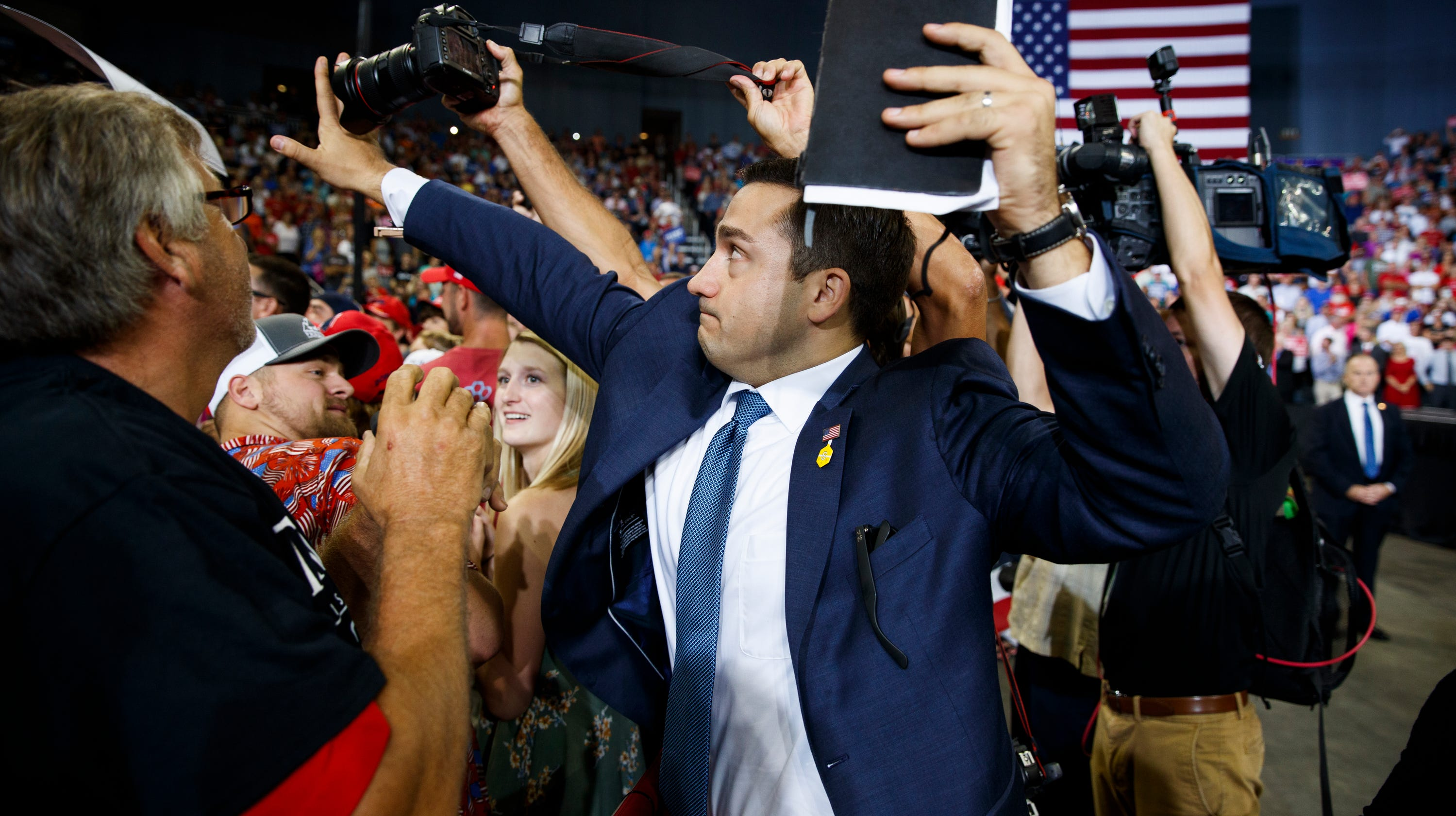Trump volunteer who blocked news photographer's camera at Indiana rally taken off road