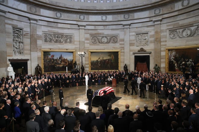 "WASHINGTON, DC - AUGUST 31: The flag-draped casket of US Senator John McCain arrives inside the Rotunda of the U.S. Capitol, August 31, 2018 in Washington, DC. A Democrat who voted for Hillary Clinton, Farone said McCain did what was right. ""He never took the easy way out, he knew actions speak louder than words and he never tweeted about it. He just got it done,"" she said. The late senator died August 25 at the age of 81 after a long battle with brain cancer. He will lie in state at the U.S. Capitol Friday, a rare honor bestowed on only 31 people in the past 166 years. Sen. McCain will be buried at his final resting place at the U.S. Naval Academy on Sunday.  (Photo by Drew Angerer/Getty Images) ORG XMIT: 775217654 ORIG FILE ID: 1028827134"