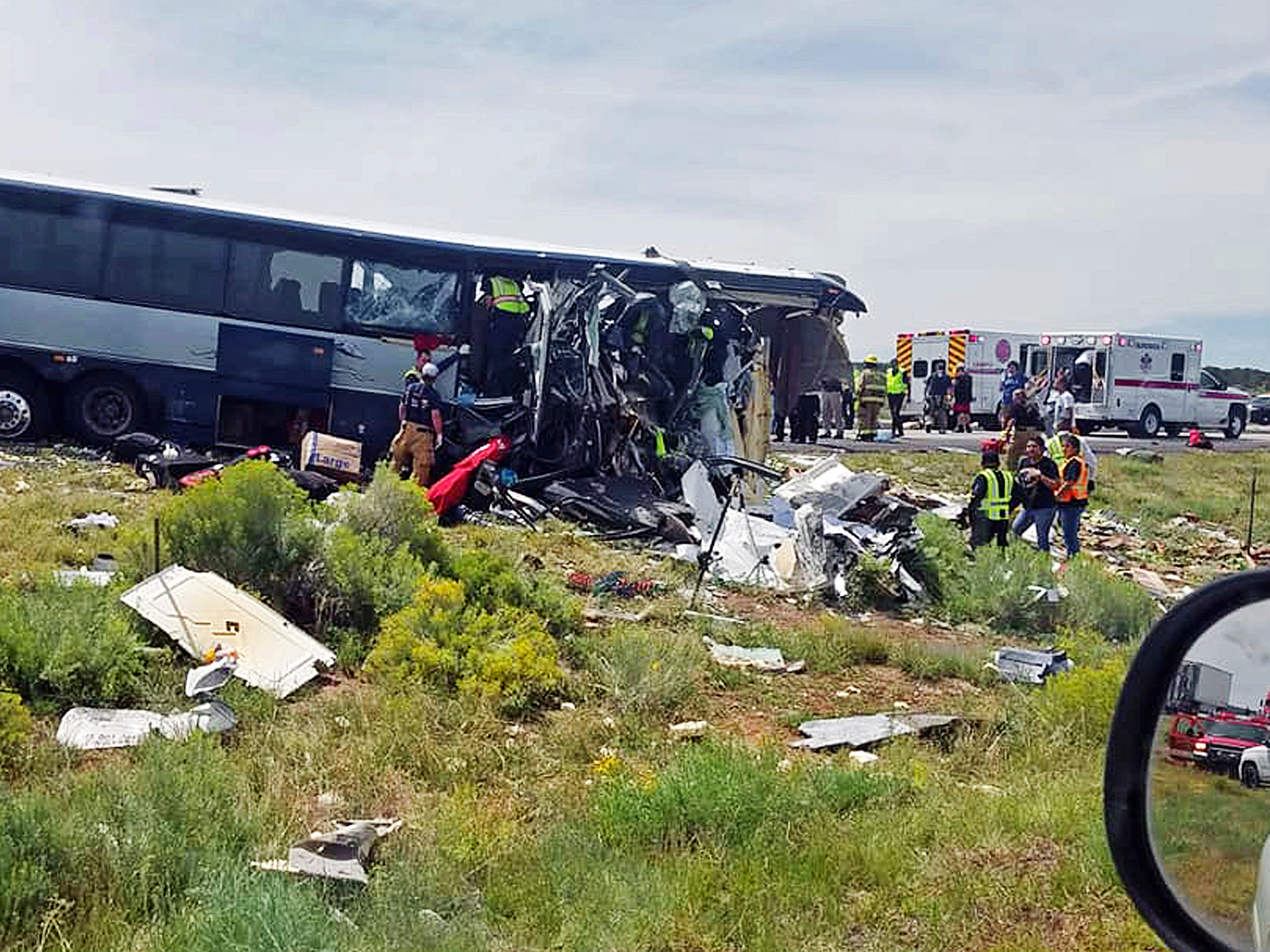 First responders working the scene of a collision between a Greyhound passenger bus and a semi-truck.