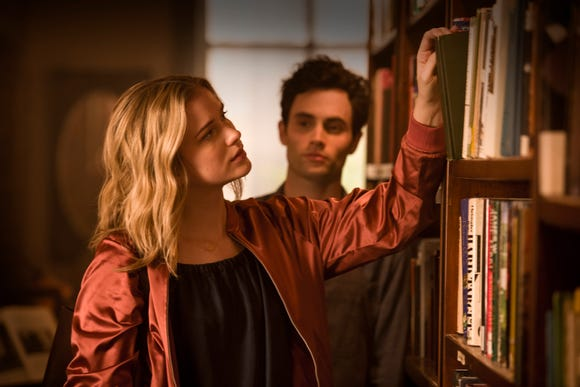 "Joe (Penn Badgley) keeps an eye on Beck (Elizabeth Lail) in Lifetime's ""You."""