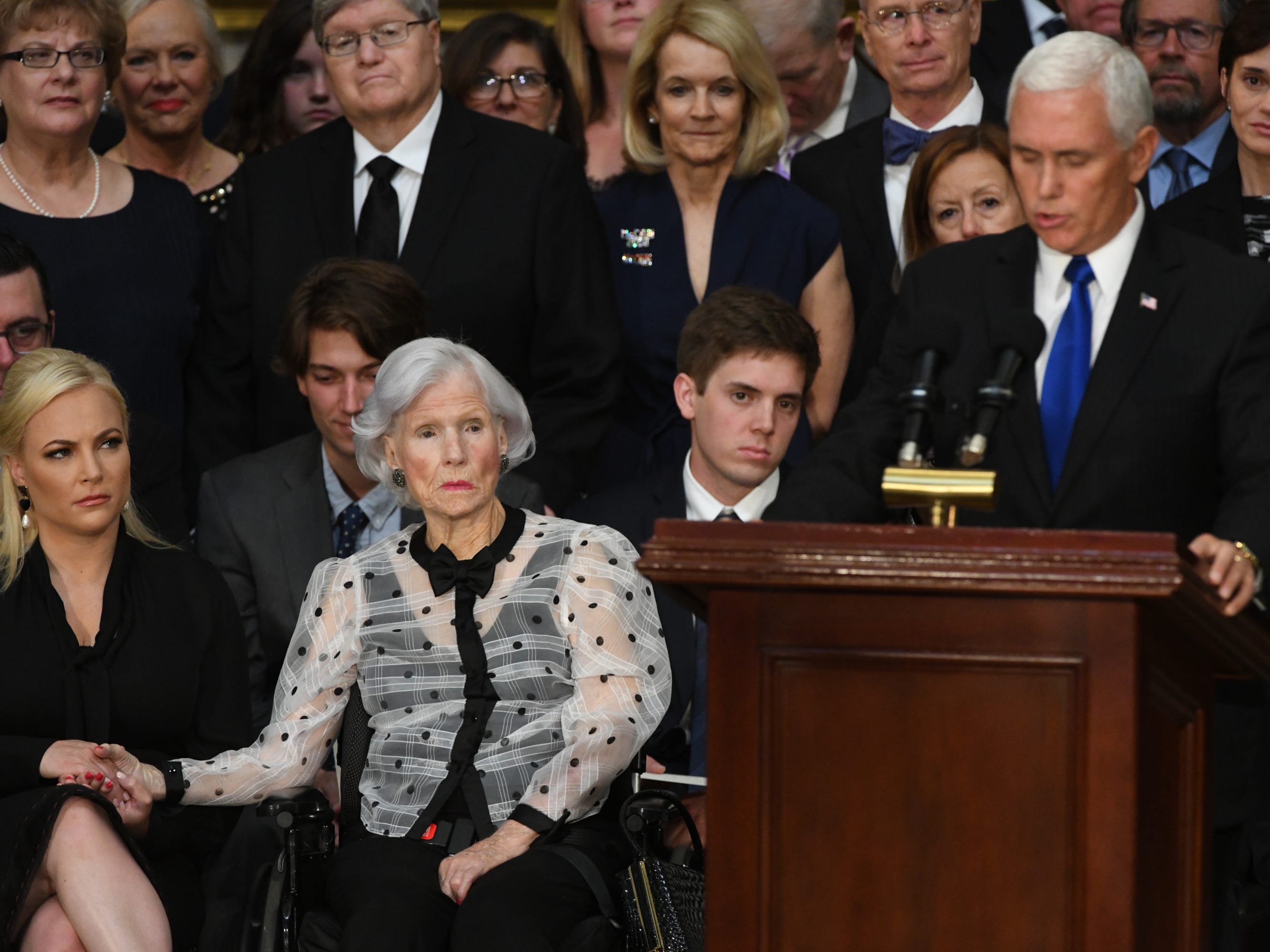 Meghan and Roberta McCain listen as Vice President Mike Pence speaks about the life of Sen. John McCain. The body of John McCain lies in state at the U.S. Capitol in Washington on Aug. 31, 2018 in Washington. Sen. McCain died on Aug. 25. --    Photo by Jasper Colt, USA TODAY Staff ORG XMIT:  JC 137436 McCain U.S. Capi 8/31/2018 (Via OlyDrop)
