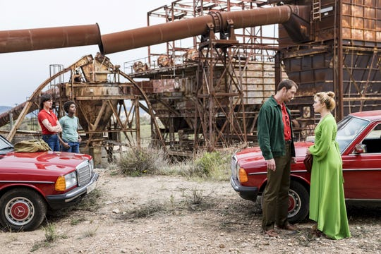 "Becker (Alexander Skarsgard) and Charlie (Florence Pugh) confer in this exclusive photo from AMC's adaptation of the John Le Carre novel, ""The Little Drummer Girl."""