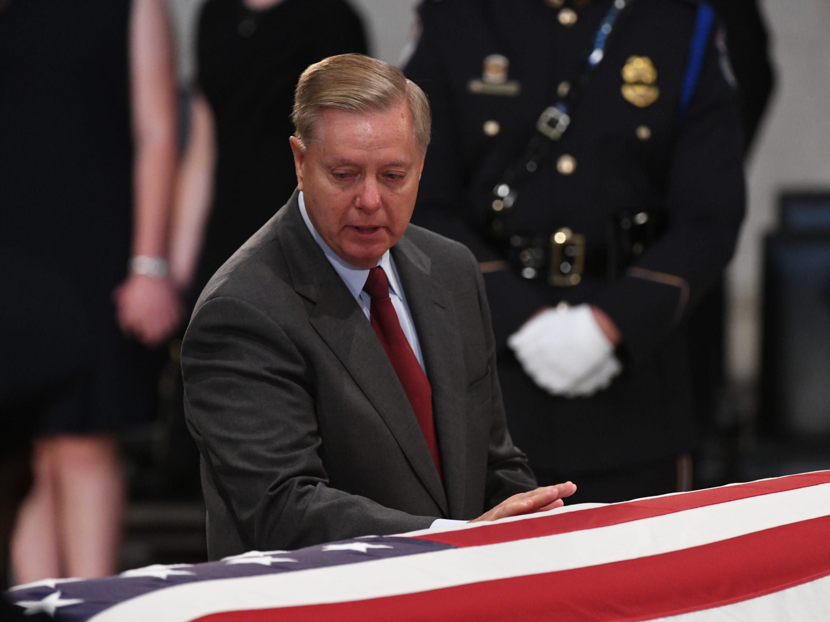 8/31/18 11:35:27 AM -- Washington, DC, U.S.A  -- Lindsey Grahama pays his respects as the body of John McCain lies in state at the U.S. Capitol in Washington on Aug. 31, 2018 in Washington. Sen. McCain died on Aug. 25. --    Photo by Jasper Colt, USA TODAY Staff ORG XMIT:  JC 137436 McCain U.S. Capi 8/31/2018 (Via OlyDrop)
