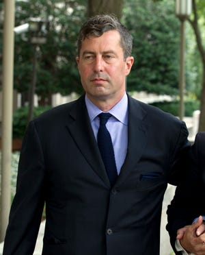 W. Samuel Patten leaves the federal court in Washington, Friday, Aug. 31, 2018. Patten entered a guilty plea in federal court in Washington, shortly after prosecutors released a four-page charging document that accused him of performing lobbying and consulting work in the United States and Ukraine but failing to register as a foreign agent as required by the Justice Department. (AP Photo/Jose Luis Magana)