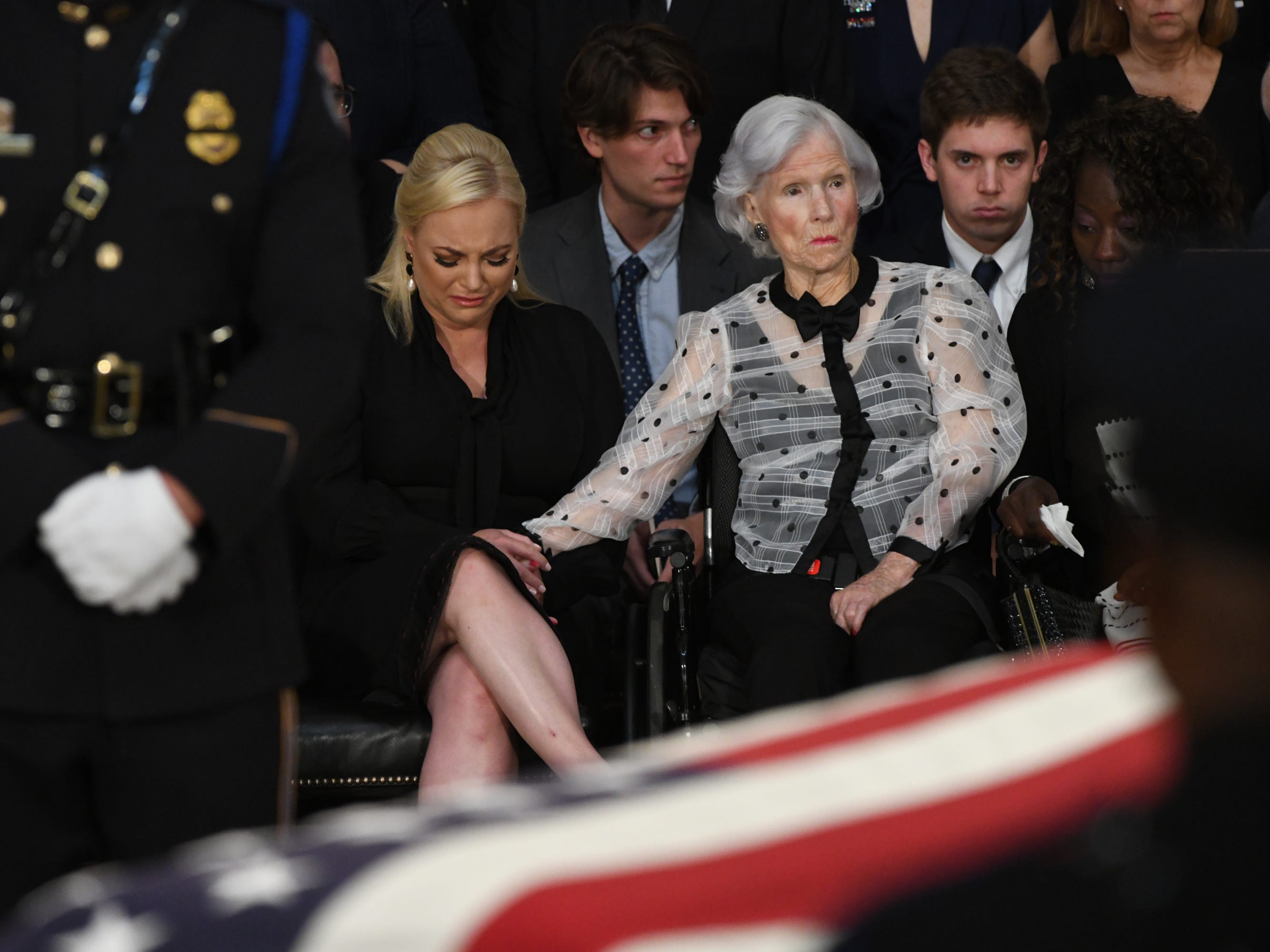 8/31/18 11:08:02 AM -- Washington, DC, U.S.A  -- Meghan and Roberta McCain hold hands as the body of John McCain lies in state at the U.S. Capitol in Washington on Aug. 31, 2018 in Washington. Sen. McCain died on Aug. 25. --    Photo by Jasper Colt, USA TODAY Staff ORG XMIT:  JC 137436 McCain U.S. Capi 8/31/2018 (Via OlyDrop)