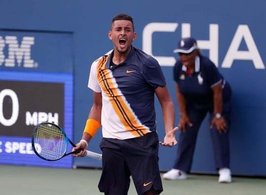 Nick Kyrgios of Austria celebrates after match point during his win against Pierre-Hugues Herbert of France.