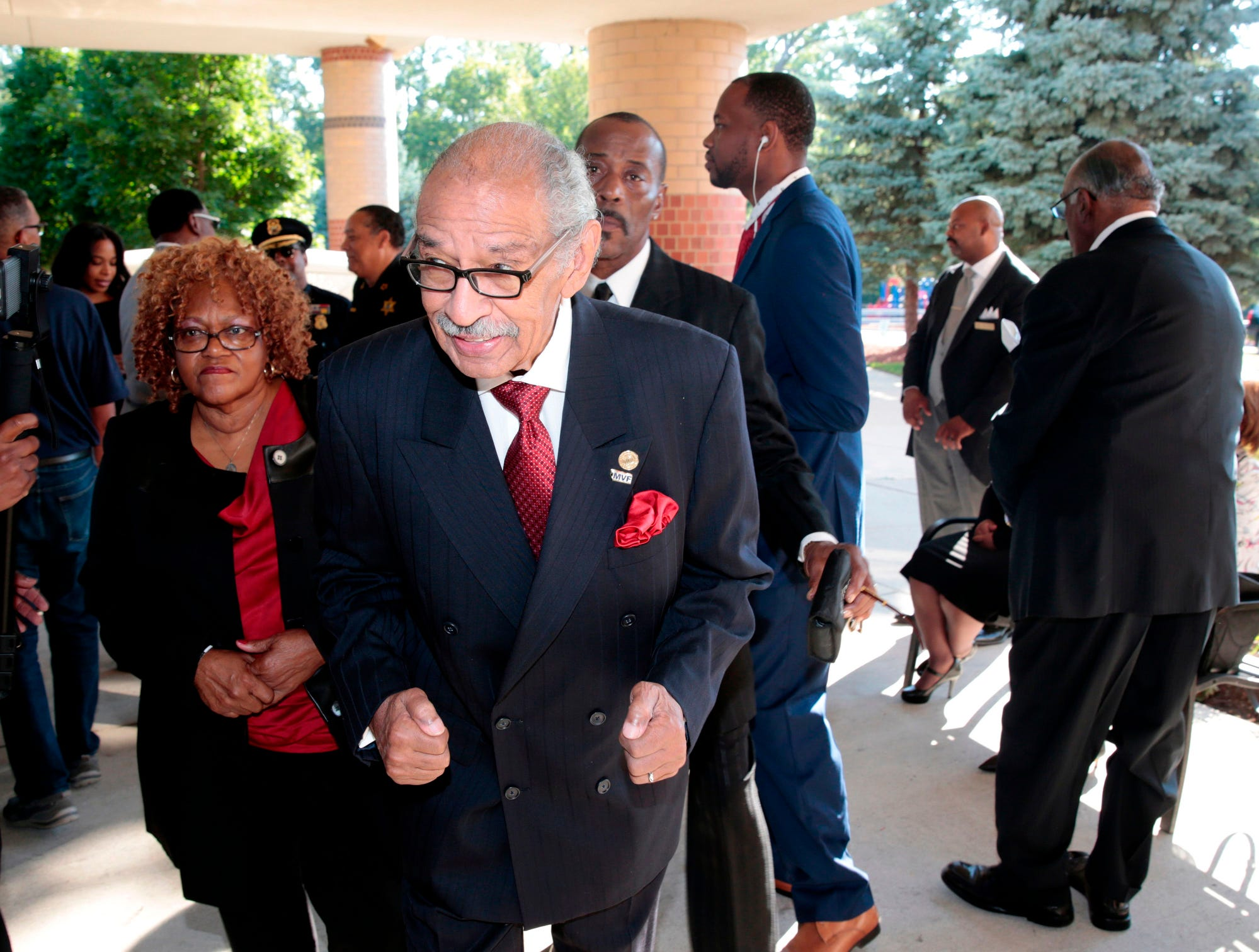 Former US congressman John Conyers arrives for Aretha Franklin's funeral.