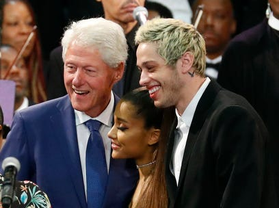 Former President Bill Clinton poses for a photo with Ariana Grande, center, and Pete Davidson, right, during the funeral service for Aretha Franklin at Greater Grace Temple, Friday, Aug. 31, 2018, in Detroit. Franklin died Aug. 16, 2018 of pancreatic cancer at the age of 76. (AP Photo/Paul Sancya) ORG XMIT: MIJR102
