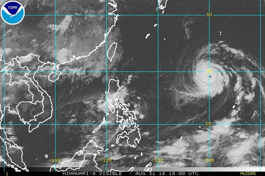 Typhoon Jebi (right) is forecast to curve to the north toward Japan over the next few days.